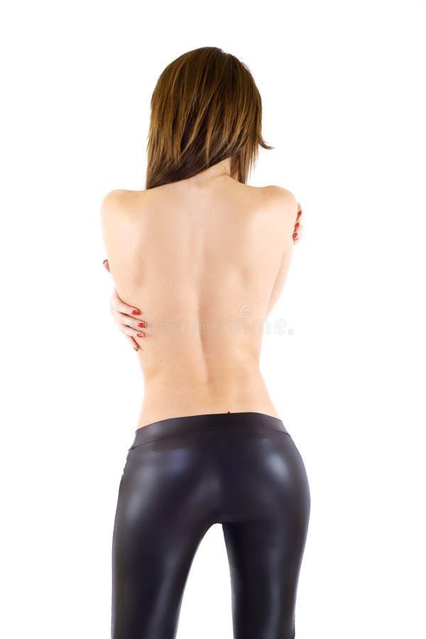 Rückseite der reizvollen Frau stockbild