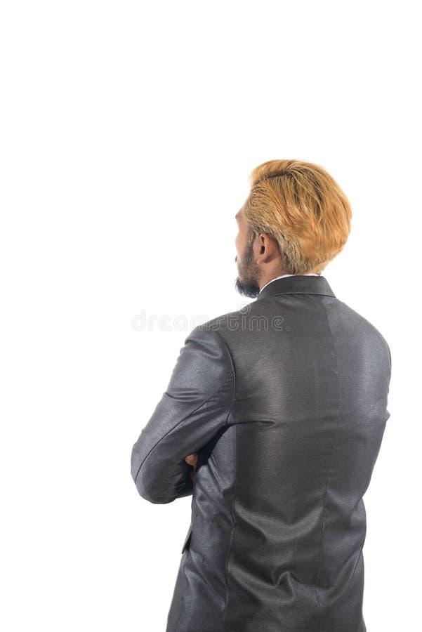 Rückseite des Geschäftsmannes schaut nach vorn Lokalisiert über Weiß lizenzfreies stockfoto