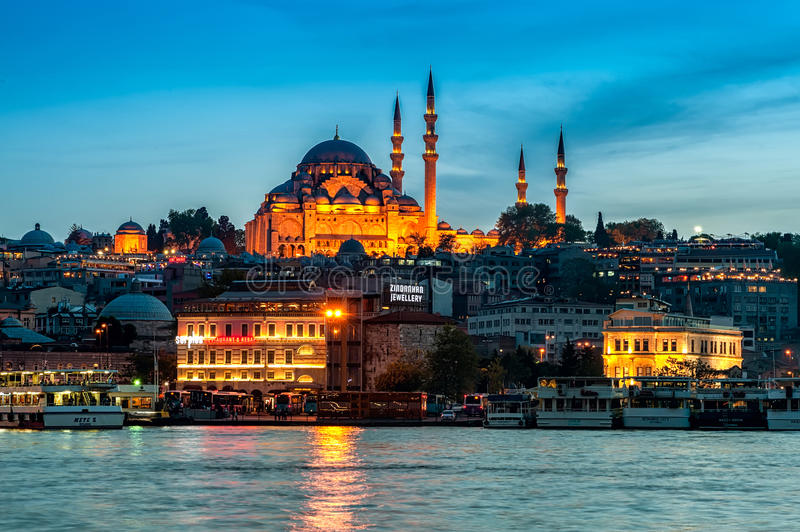 Rüstem Pasha Mosque. Fatih district at night, view from Galata Bridge in Istanbul, Turkey royalty free stock images