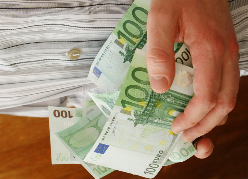 ręce pełne pieniędzy zdjęcie stock