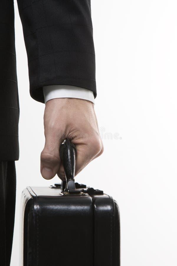 ręce walizkę gospodarstwa fotografia stock