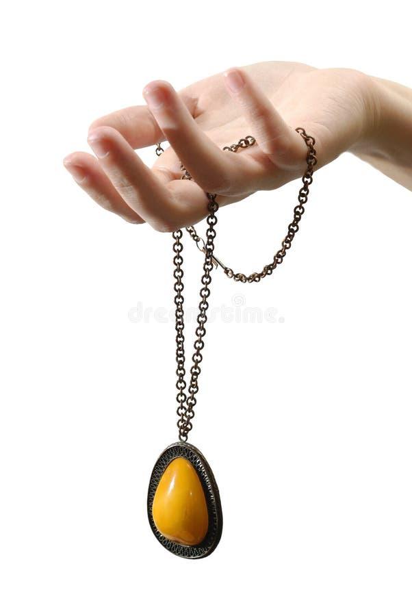 ręce złota pojedynczy wisiorek obraz royalty free
