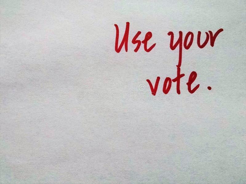 Ręcznie pisany czerwoni listy na prostym tła ` Używają twój głosowania ` fotografia stock