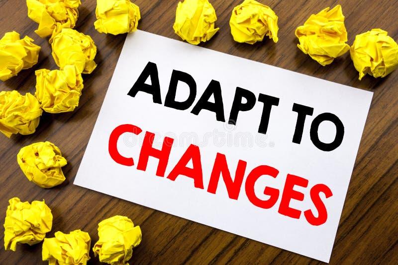 Ręcznie pisany teksta seansu słowo Adaptuje zmiany Biznesowej pojęcia writing adaptaci Nowa przyszłość Pisać na kleistym nutowym  fotografia stock