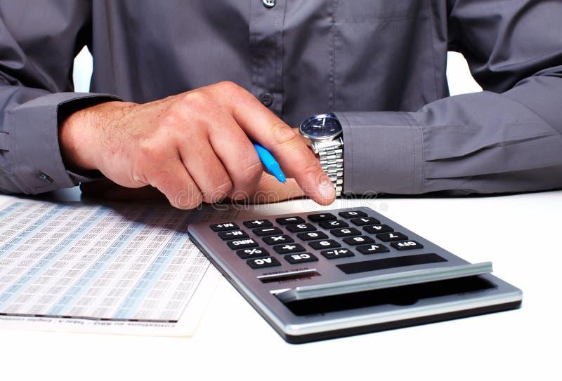 Ręka biznesmen z kalkulatorem obraz stock