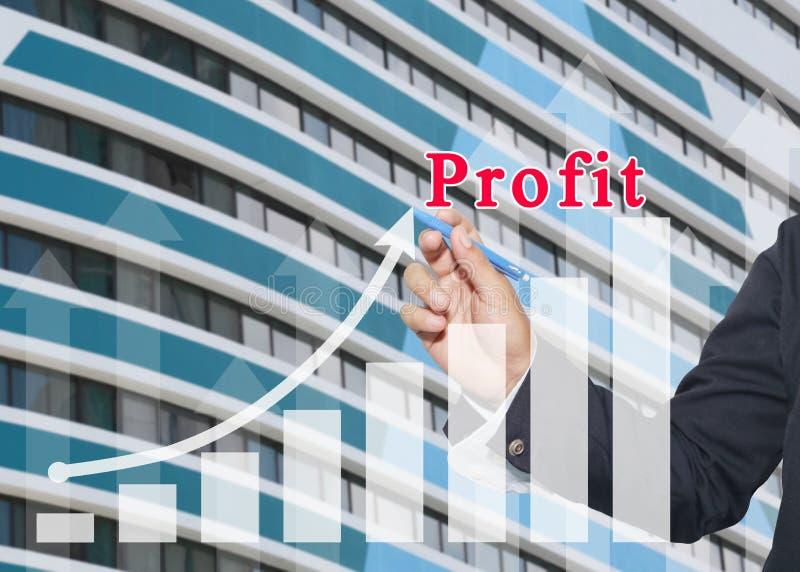 ręka biznesmena use pióro pisze biznesowym wykresie zdjęcia stock