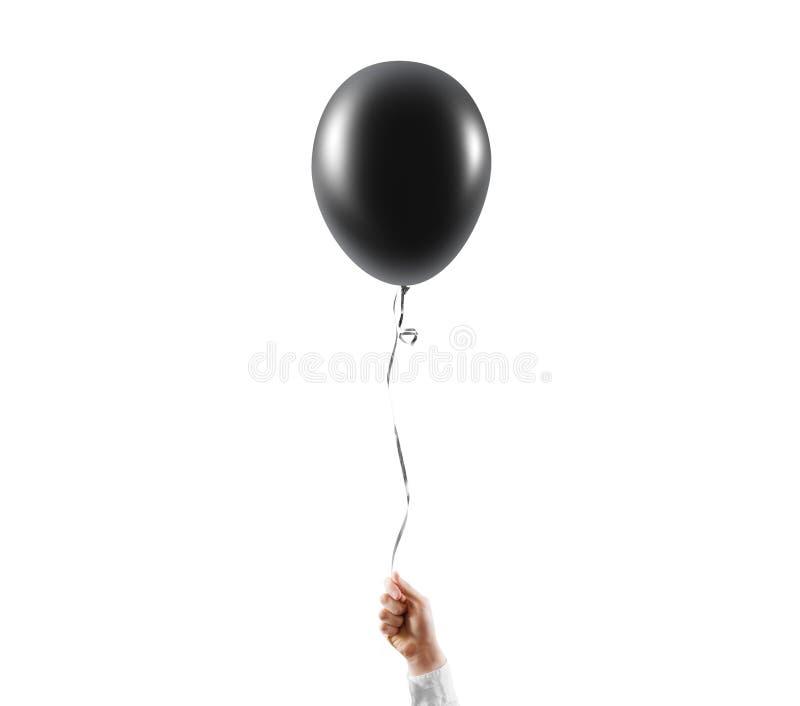 Ręka chwyta czerni balonu pusty egzamin próbny up odizolowywający Balonowa sztuka obrazy stock