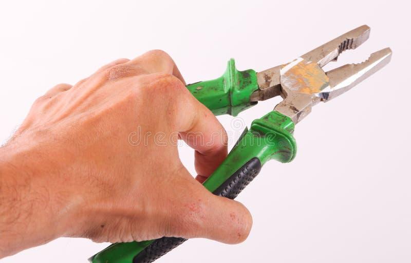 Ręka chwyta narzędzie obrazy royalty free