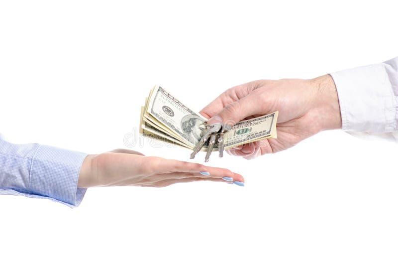Ręka daje klucza i pieniądze dolarom ręka obrazy royalty free