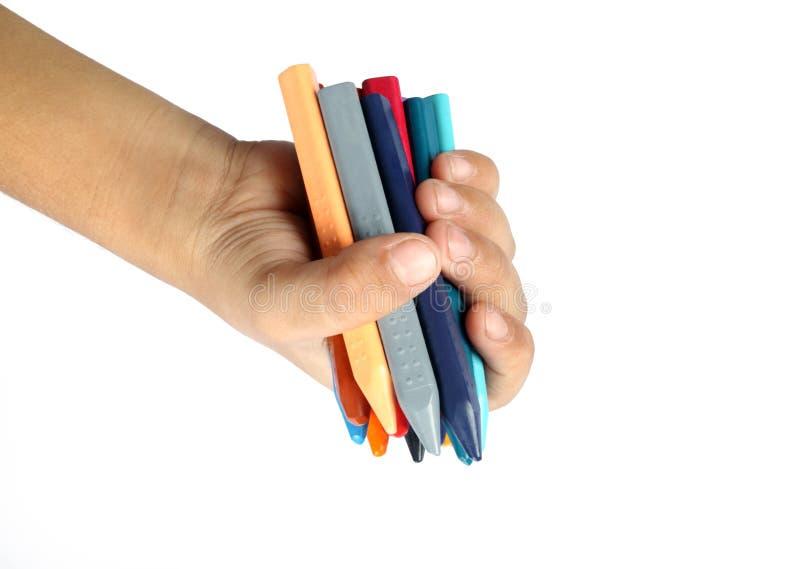 Ręka i kredki zdjęcia stock