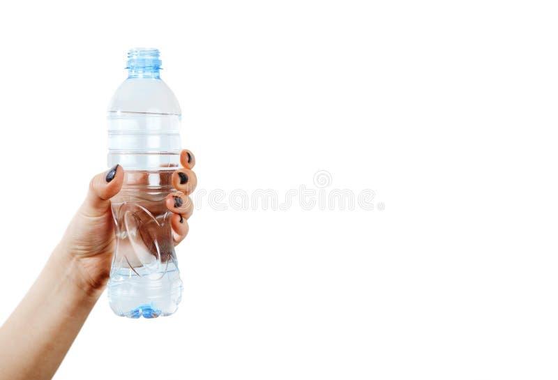Ręka kobieta z butelką kąt obrazy stock