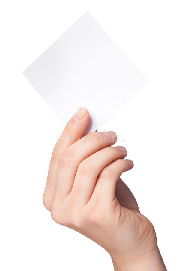 Ręka kobiety trzyma pustego papieru etykietkę zdjęcie stock