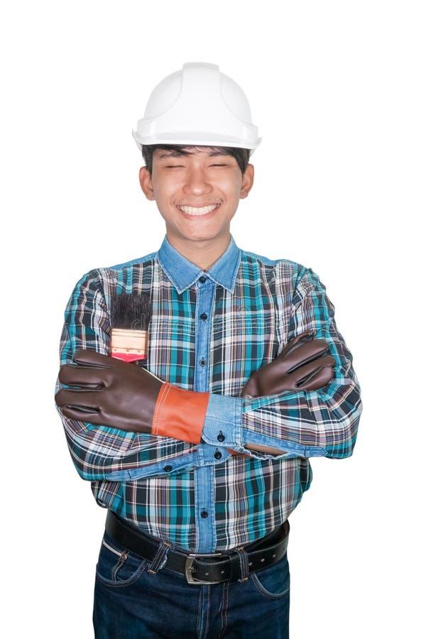 Ręka krzyż inżyniera mienia farby muśnięcia odzież Paskował koszulową błękitną i rękawiczkową skórę z białym zbawczego hełma klin zdjęcia stock
