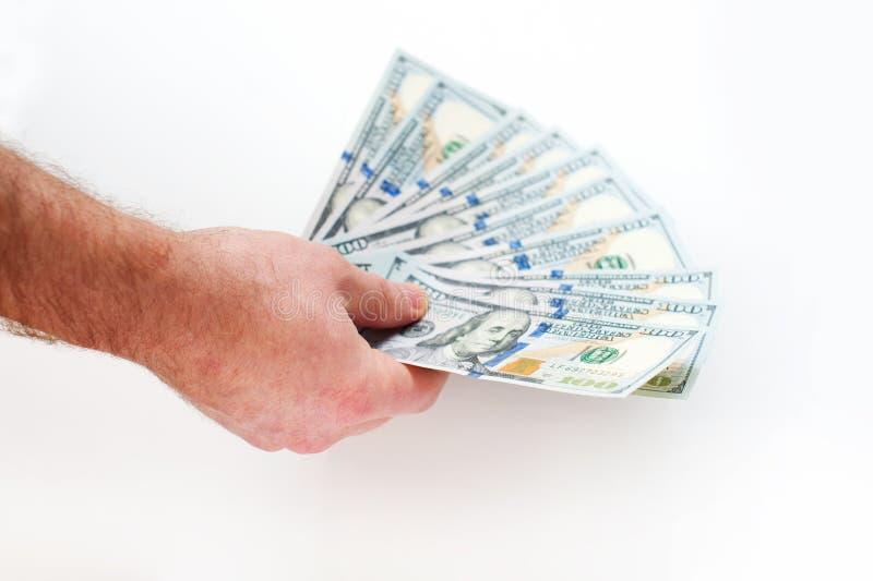 Ręka mężczyzna mienie wachlował fistful dolarów rachunki fotografia stock