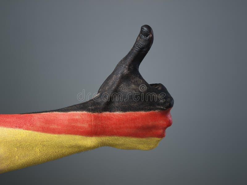 Ręka malująca z flaga Niemcy fotografia stock