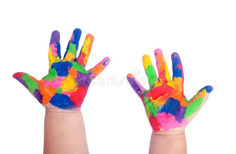 Ręka malujący dziecko na bielu obraz stock