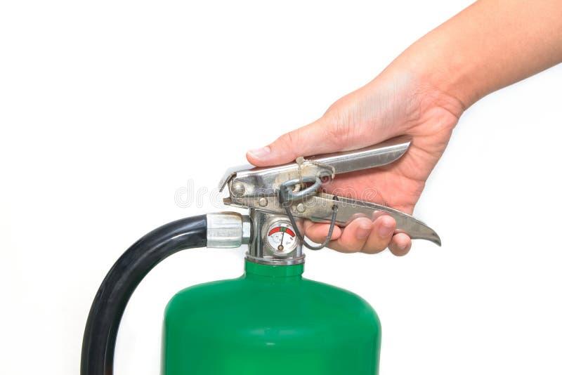 Ręka naciskał spustowego zielonego pożarniczego gasidło zdjęcie royalty free