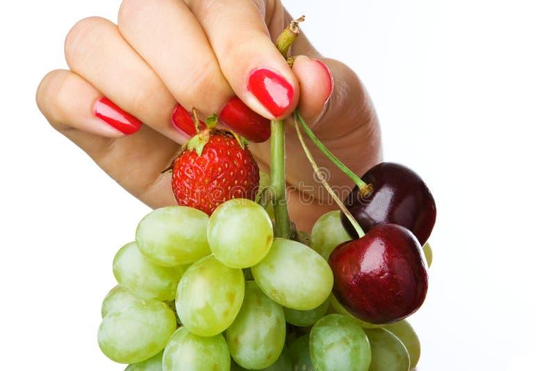 ręka pełna owocowych zdjęcia stock