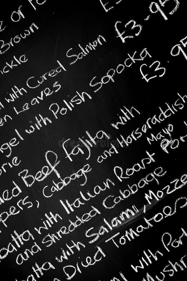 Ręka pisać kredowego menu deskowi featureing różnorodni składniki obrazy stock