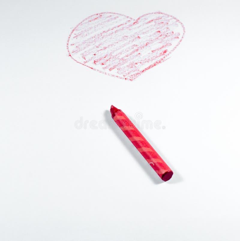 Ręka remis czerwoną kredką, kierowy kształt odizolowywający na białym backgroun obraz royalty free