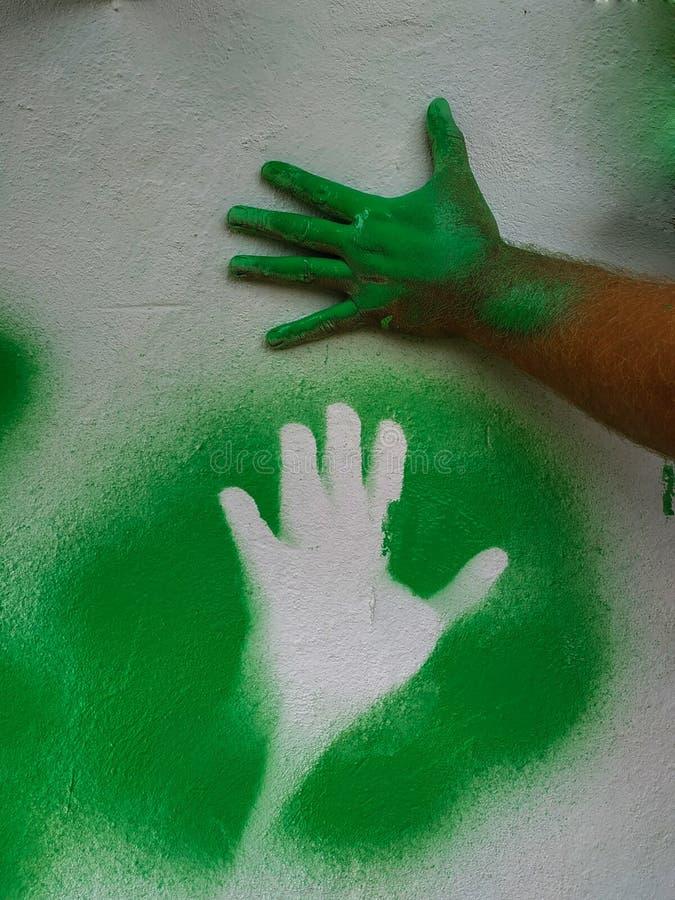 Ręka truizmu zieleni farba 5 obraz stock