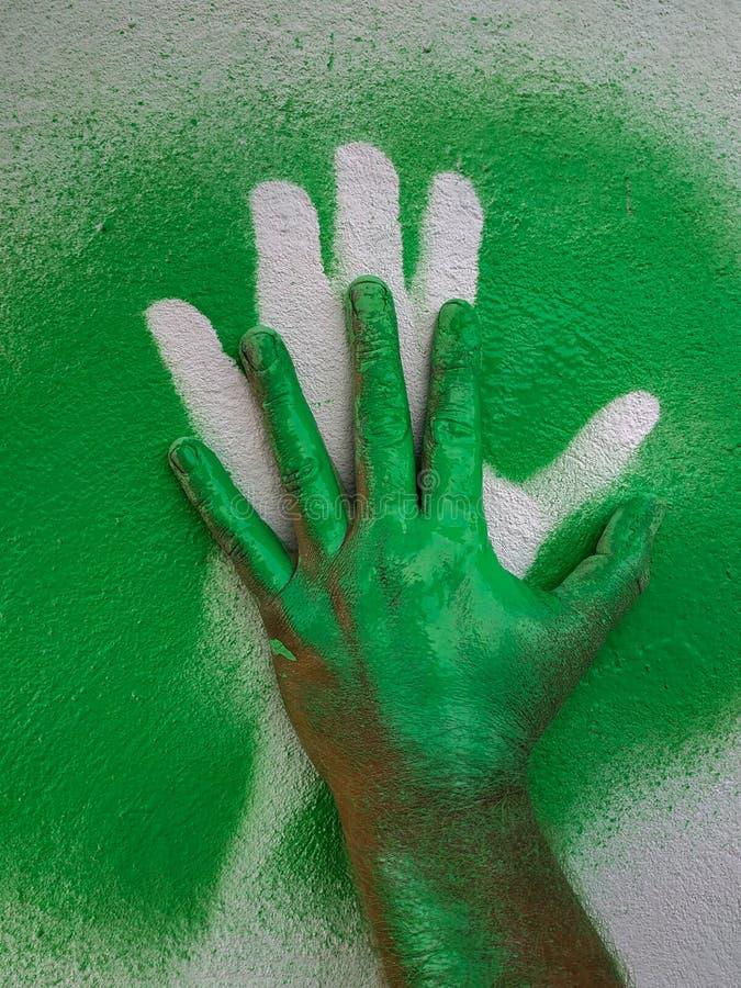 Ręka truizmu zieleni farba 3 obrazy stock