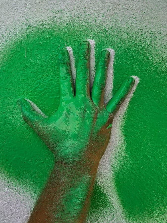 Ręka truizmu zieleni farba 2 zdjęcia stock