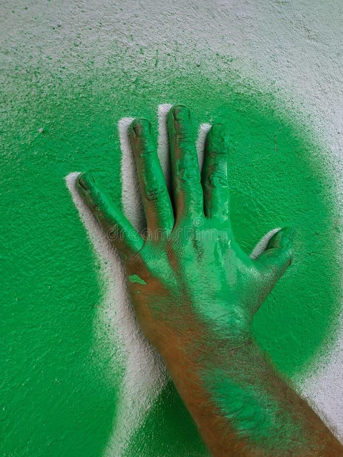 Ręka truizmu zieleni farba 1 obrazy stock