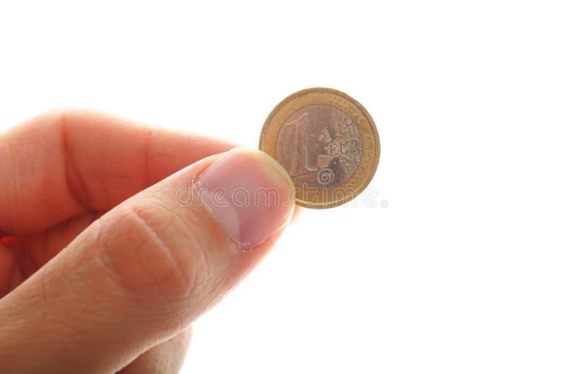 Ręka trzyma jeden euro zdjęcia stock