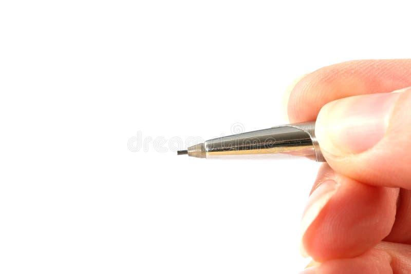 Ręka trzyma ołówek zdjęcie stock