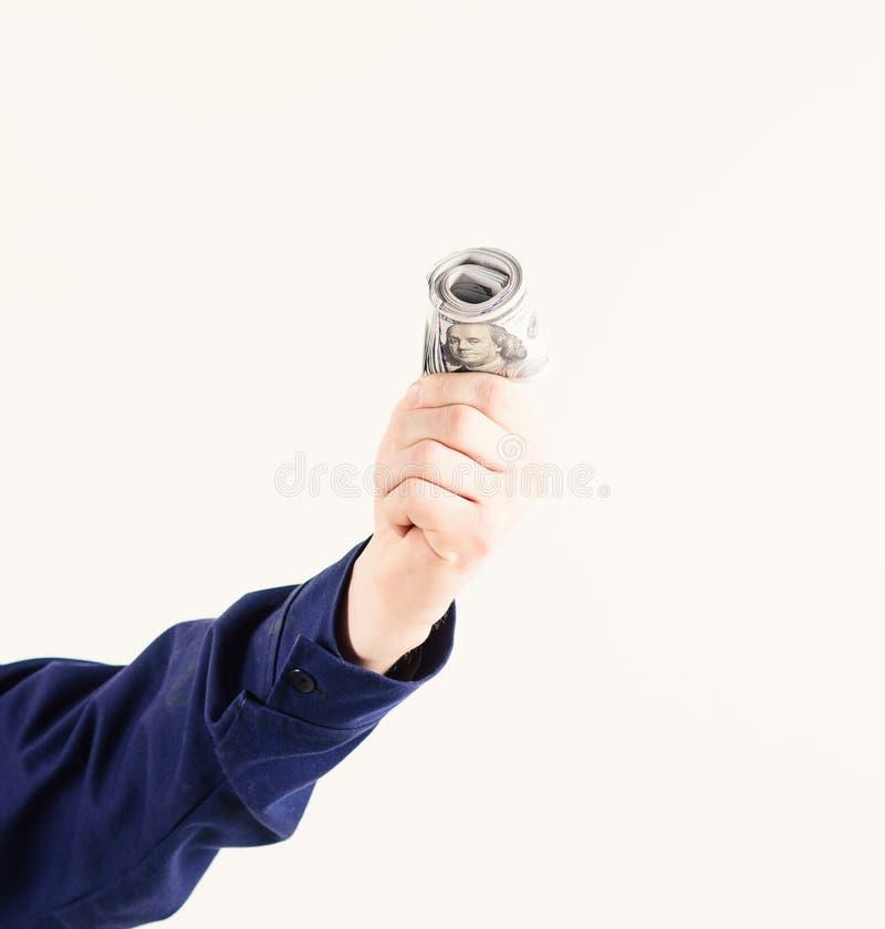 Ręka trzyma pieniądze, gotówka, dolarowi banknoty Rolka pieniądze, łapówka, gotówka, podatek, biały tło Bezprawny zysku pojęcie fotografia stock
