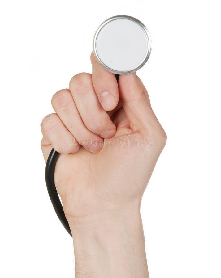 Ręka trzyma stetoskop odizolowywający na bielu zdjęcia royalty free