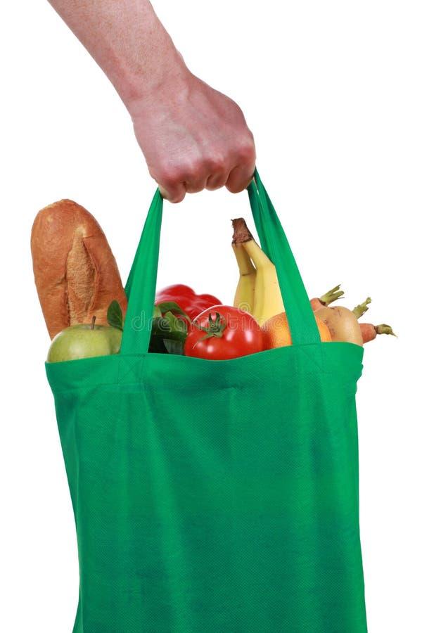 Ręka trzyma torbę z sklepami spożywczy fotografia stock