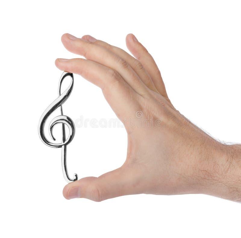 Ręka trzyma treble clef obrazy royalty free