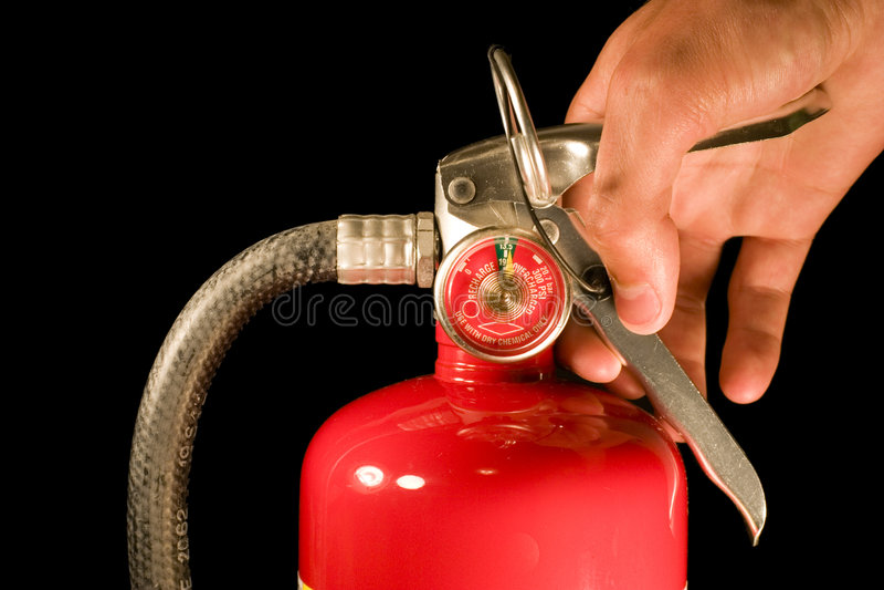 ręka trzymająca gaśnicę ogień obrazy royalty free