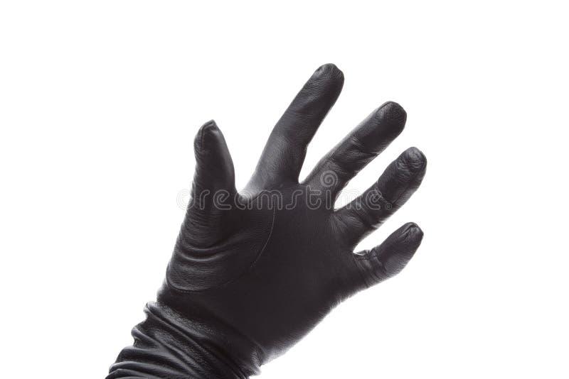 Ręka w czarnych rzemiennych rękawiczkach obraz royalty free