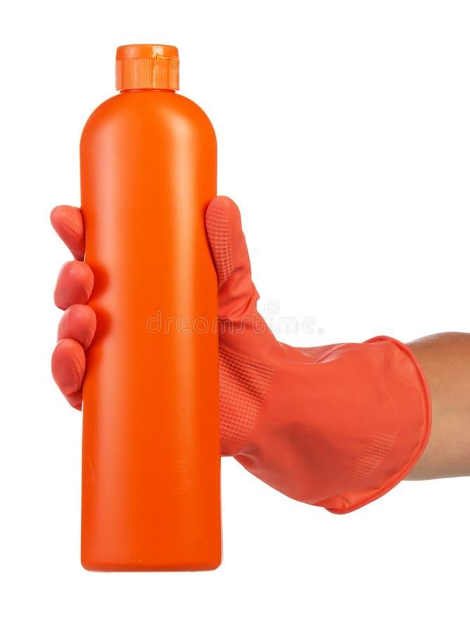 Ręka w lateksowej rękawiczce z cleaning produktem obrazy stock