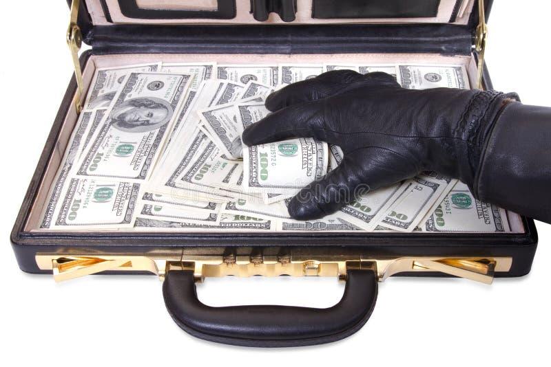 Ręka w rękawiczce bierze pieniądze fotografia stock