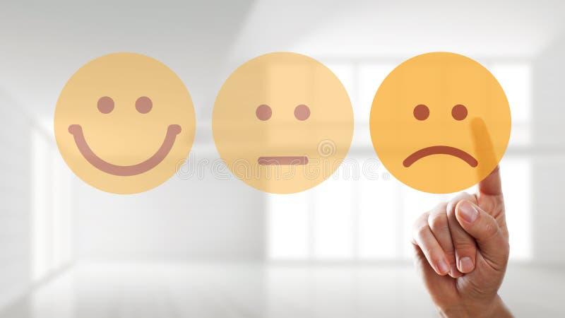Ręka wybiera smutnego trybowego smiley zdjęcie stock