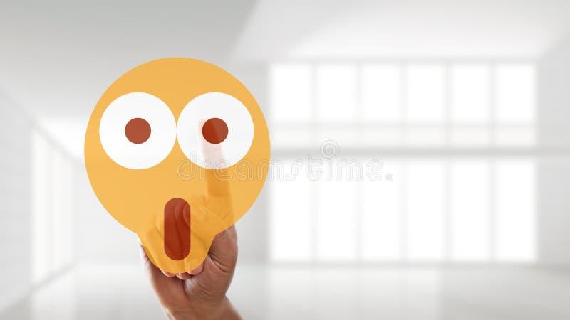 Ręka wybiera zdziwionego trybowego emoticon zdjęcia royalty free