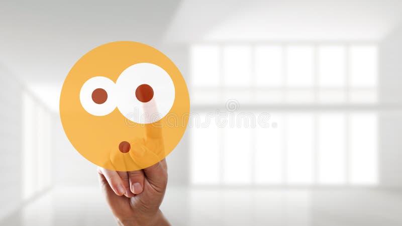 Ręka wybiera zdziwionego trybowego emoticon fotografia stock