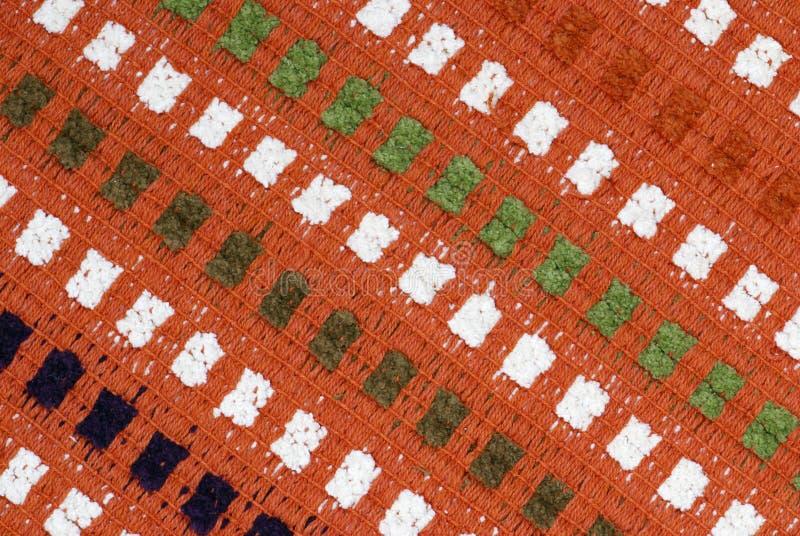 Ręka wyplatający dywan fotografia stock