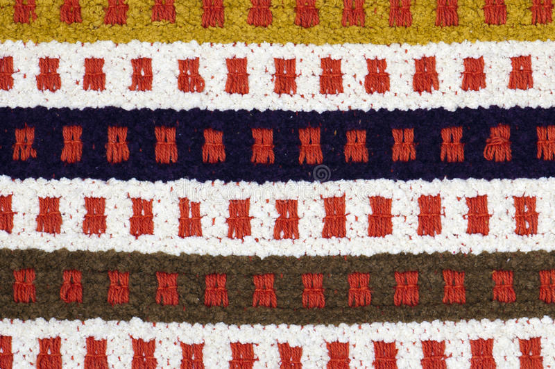 Ręka wyplatający dywan zdjęcia royalty free