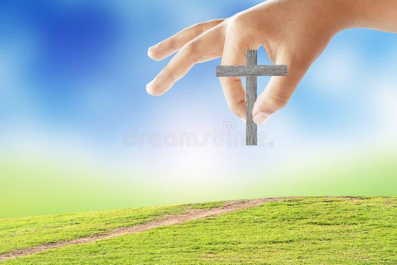 Ręka wziąć krzyż zdjęcie royalty free