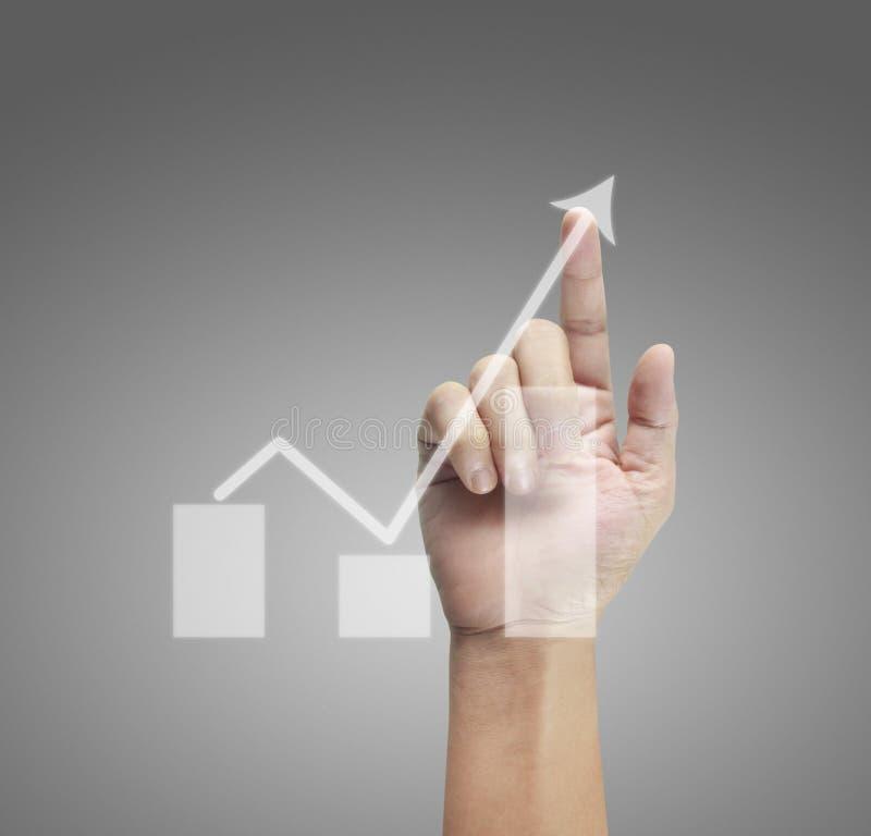 Ręka wzruszający wykresy pieniężny wskaźnik fotografia royalty free
