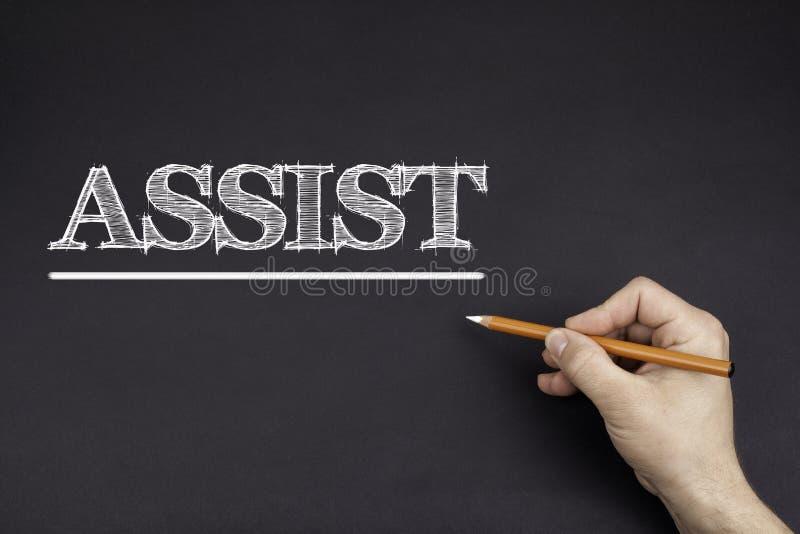 Ręka z białym ołówkowym writing: ASYSTA zdjęcie royalty free