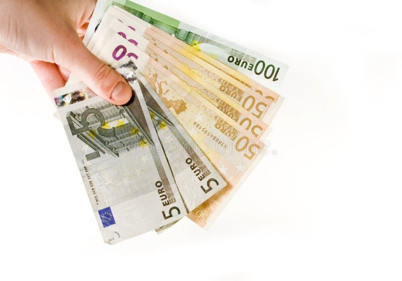 Ręka z euro odizolowywającym na bielu obrazy royalty free