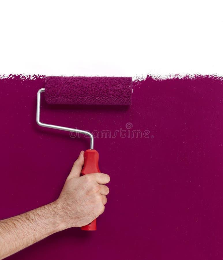 Ręka z farba rolownikiem obrazy stock