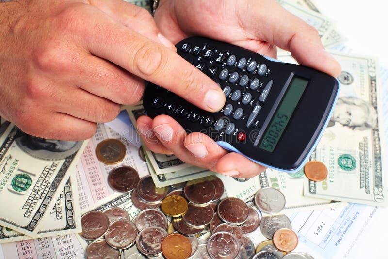 Ręka z kalkulatorem i pieniądze. zdjęcie royalty free