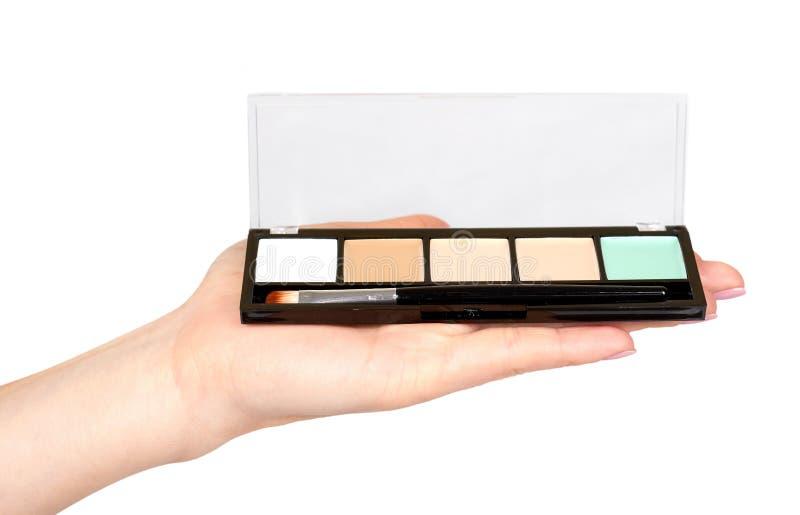 Ręka z kolor paletą, oka makeup muśnięcie zdjęcia royalty free